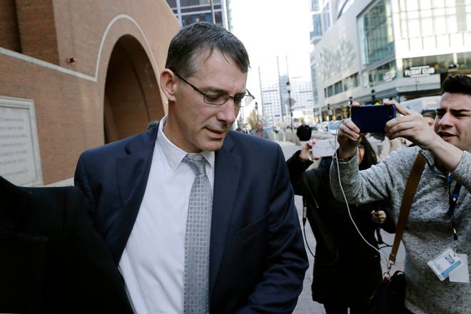 Michael Center, former men's tennis coach at the University of Texas-Austin, leaves federal court in Boston on Feb. 24 after being sentenced in a nationwide college admissions bribery scandal.