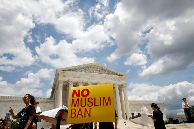 People protest against the Supreme Court ruling upholding President Donald Trump's travel ban outside the Supreme Court in Washington, Tuesday, June 26, 2018.