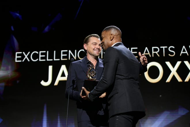 Leonardo DiCaprio presents Jamie Foxx with his award at the 2020 ABFF Honors.