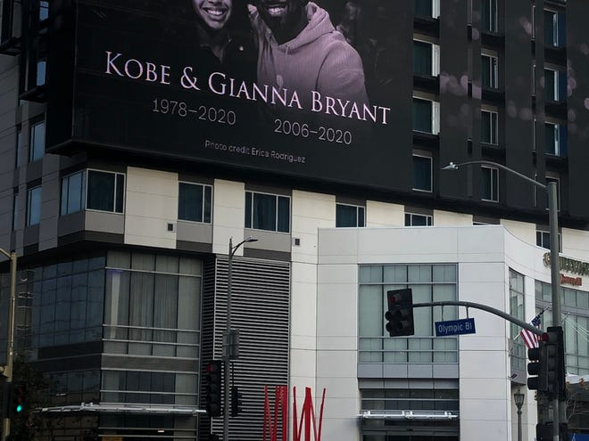 A billboard in Los Angeles pays respect to Kobe Bryant and his daughter, Gianna.