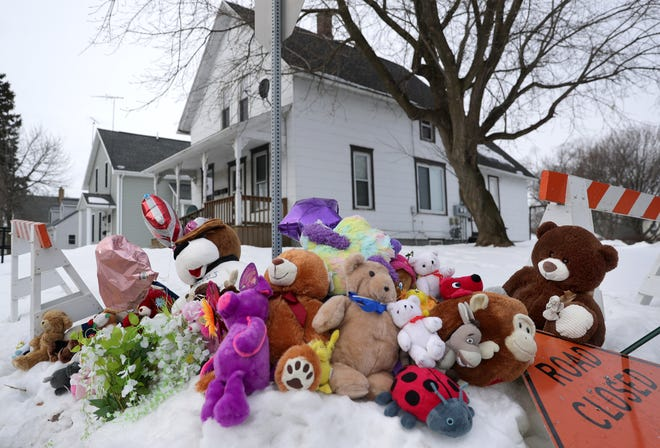 A memorial of stuffed animals sits outside the home where William Beyer, 5, and Danielle Beyer, 3, were found dead by police shortly after 7 a.m. Feb. 17.