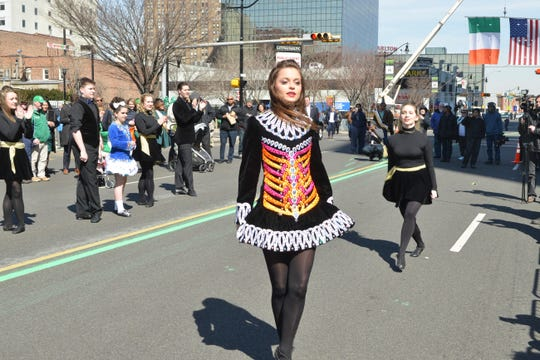 Irish step dancers take part in Newark's St. Patrick's Day parade.