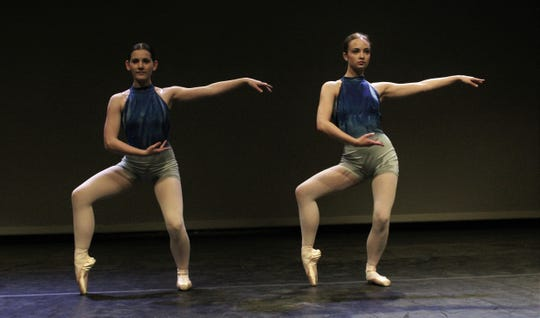 """Grace Ann Alston, left, and Laurel Sanders mimic each other as they dance to """"La Follia"""" by Vivaldi, one of a dozen performances that comprise """"One Night Only,"""" Abilene Christian University's winter show. Feb. 24 2020"""