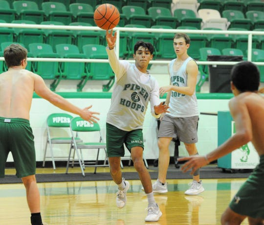 Hamlin's Austin Castillo makes a one-handed pass during practice Wednesday, Feb. 19, 2020, at Piper Court in Hamlin.