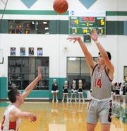 Eastland junior Behren Morton (14) takes a 3-pointer against Anson in a Region I-3A bi-district playoff Monday at Breckenridge High School.