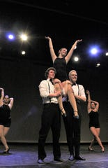 """Riley Dodd is lifted in rehearsal by Corban Gilliland, left, and Jack Bledsoe in """"Don't Rain on My Parade,"""" one of a dozen numbers to be danced in """"One Night Only"""" this weekend at Abilene Christian University."""