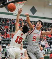 Eastland's Matthew Moreno (5) blocks a layup attempt by Anson sophomore Dylyn Pyle in a Region I-3A bi-district playoff Monday at Breckenridge High School.