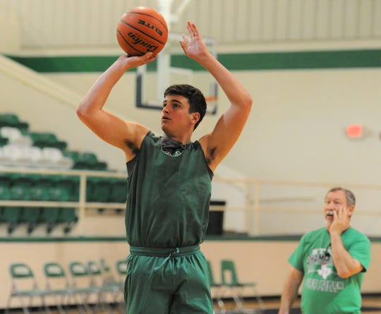 Hamlin junior Ethan Byerly takes a jumper as Pied Pipers coach Joe Thomasson looks on during practice Wednesday, Feb. 19, 2020, at Piper Court in Hamlin.