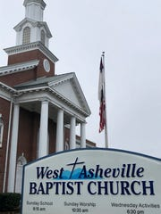West Asheville Baptist church flies a Christian flag above the American flag. While this technically goes against flag etiquette, the church's pastor said not disrespect is intended.