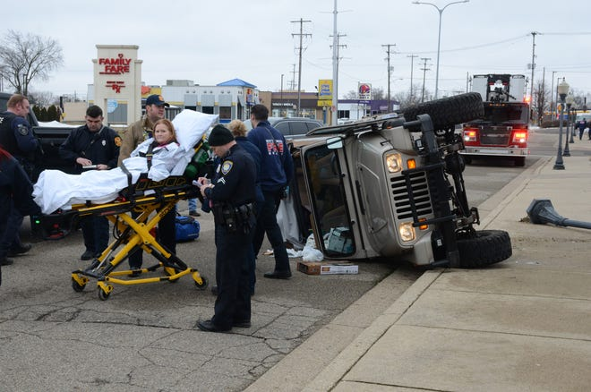 The driver of a Jeep is taken to the ambulance after a crash Tuesday on Capital Avenue Southwest.