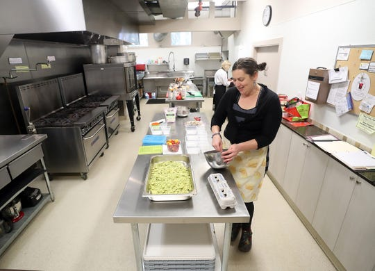 Natalie Vaughan-Wynn whips up a batch of coconut cookies as she prepares meals for her Nom Nom Lunch Club in the kitchen of St. Barnabas Episcopal Church on Tuesday, Feb. 25, 2020.