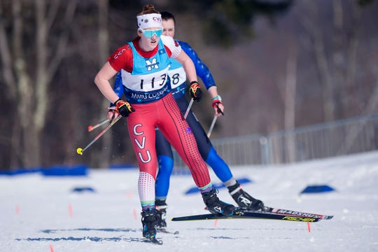 Champlain Valley's Emma Strack is shadowed by a U-32 skier in the final strides of the girls 5K freestyle during the high school Nordic skiing state championships at Camp Ethan Allen in Jericho on Monday, Feb. 24, 2020.