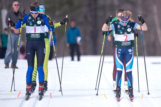 U-32's Isabelle Serrano, left, and Mount Mansfield's Lily Porth ready for the start of the girls freestyle relay during the high school Nordic skiing state championships at Camp Ethan Allen in Jericho on Monday, Feb. 24, 2020.
