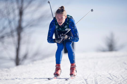 U-32's Waylon Kurts tucks down a hill on the boys freestyle relay during the high school Nordic skiing state championships at Camp Ethan Allen in Jericho on Monday, Feb. 24, 2020.