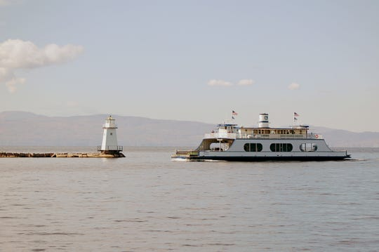 """The """"Adirondack"""" ferry, operated by Lake Champlain Transportation Company, operates north of the Burlington breakwater in the 1990s."""