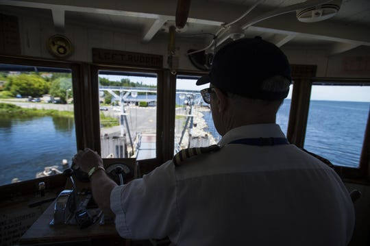 """Captain Jerry Williams guides the Lake Champlain Transportation Company's """"Adirondack"""" ferry into Port Kent N.Y. after crossing Lake Champlain from Burlington on June 17, 2015."""