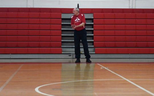 Incarnate Word Academy girls basketball coach Malcolm Smith watches his team practice, Tuesday, Feb. 25, 2020. The team is preparing for the state tournament.