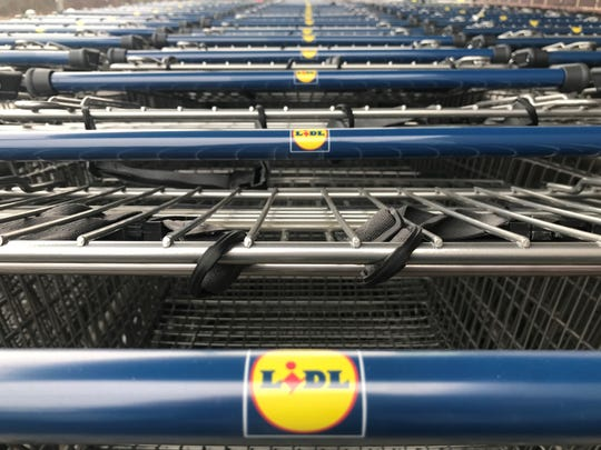 Shopping carts are lined up outside a Lidl store set to open Wednesday morning at Route 38 and Cuthbert Boulevard, Cherry Hill.