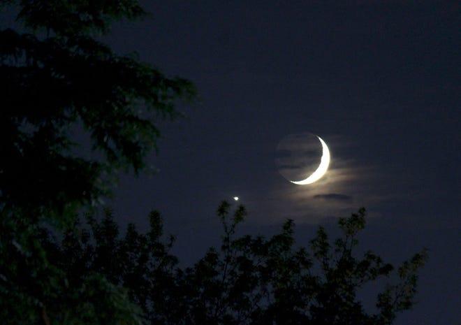 Crescent moon next to dazzling Venus.
