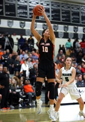 Loveland forward Jillian Hayes grabs a rebound.