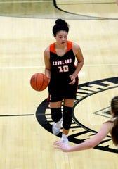 Loveland forward Jillian Hayes brings the ball up the court.
