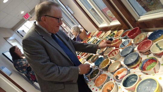 Frank Lott picks out a bowl during the Empty Bowls event on Tuesday at the Trinity Episcopal Church lunch site.