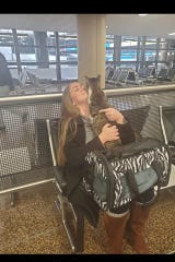 Anne Shackelford reunites with Riley, the cat she lost for almost a year when she moved from Clarksville to Seattle.