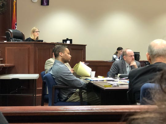 Defendant Quentin Bird looks at evidence shown for a 2017 case involving the death of his pregnant ex-girlfriend,  in Judge Jill Ayers' courtroom at Montgomery County Court in Clarksville, Tenn., on Feb. 24, 2020.