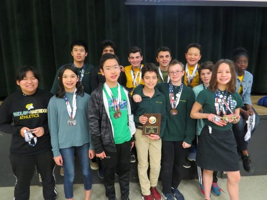 Middle School swimmers display the many medals they earned at the Ranney Invitational.