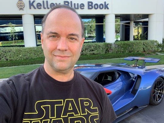 Karl Brauer, executive editor of Kelley Blue Book, urges people to consider car colors other than white, black and silver. He took this photo in Irvine, California on May 3, 2019.