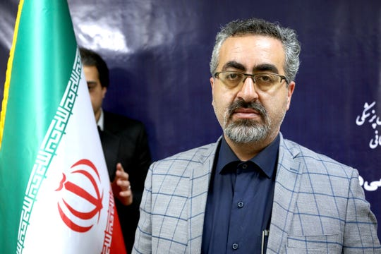 Spokesman for Iran's Health Ministry Kianoush Jahanpour poses for a photo before an interview in Tehran, Iran, Tuesday, Feb. 25, 2020.