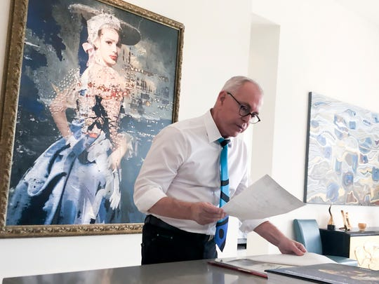 Robert Julian Stone looks over his medical records in his home in Palm Springs, Calif., on Jan. 20.