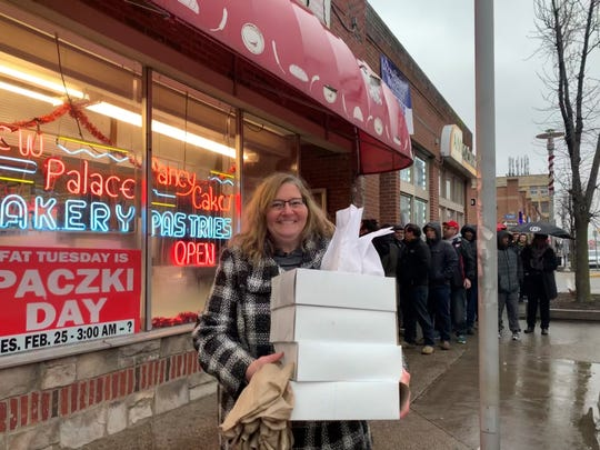 Edie Chudnow, 58, is from Arizona but is in Michigan for work and decided to stop by New Palace Bakery in Hamtramck on Tuesday for Paczki Day.