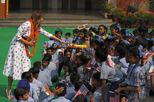 U.S. first lady Melania Trump shakes hand with children at Sarvodaya Co-Educational Senior Secondary School in New Delhi, India, Tuesday, Feb. 25, 2020.
