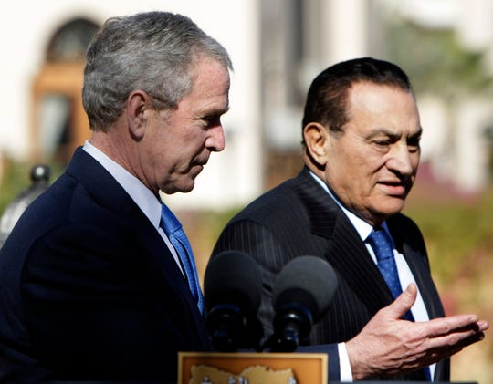 President George W. Bush and Egyptian President Hosni Mubarak arrive in January 2008 for a joint statement in Sharm el-Sheikh, Egypt. Mubarak, who was ousted in the 2011 Arab Spring uprising, has died at 91.