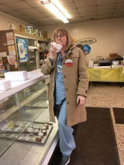 Nancy Drain of Canton used to ride the bus to Sisters Cakery on Fat Tuesday with her mother. She left Tuesday with 2 1/2 dozen — plus one custard paczek to eat on the spot, and one prune paczek that she always leaves by her parents' graves.