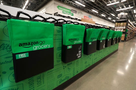 Reusable shopping bags are displayed inside an Amazon Go Grocery store in Seattle's Capitol Hill neighborhood.