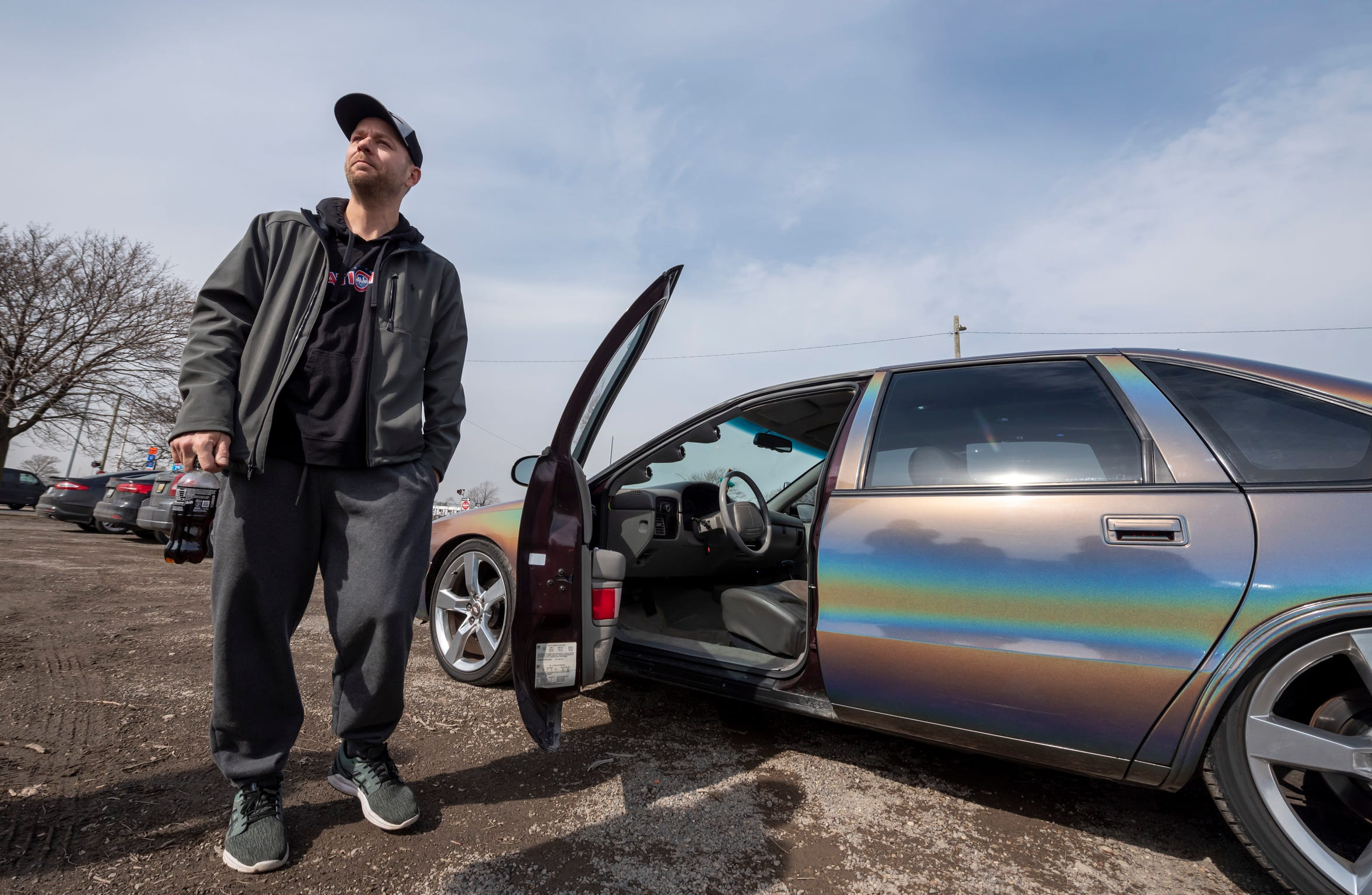 Dan Gersch stands next to his 1996 Chevy Impala SS, in Detroit.