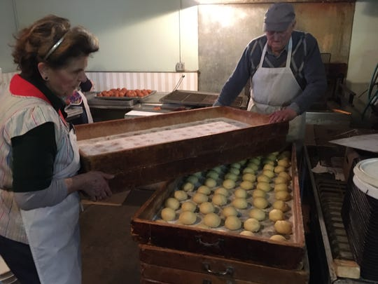 Susan and Mike Radovanovic encourage hand-rolled paczki to rise at Sisters Cakery in Detroit. Her late father built the wooden crates for the bakery he bought 51 years ago.
