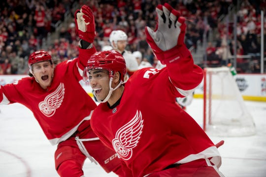 Red Wings center Andreas Athanasiou, right, celebrates a goal with Tyler Bertuzzi against the Panthers at Little Caesars Arena in 2018.