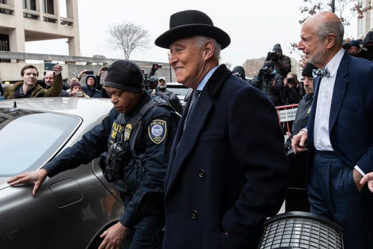 Roger Stone, center, departs federal court in Washington, Feb. 20, 2020. President Donald Trump loyalist and ally, Roger Stone was sentenced to over three years in federal prison, following an extraordinary move by Attorney General William Barr to back off his Justice Department's original sentencing recommendation.