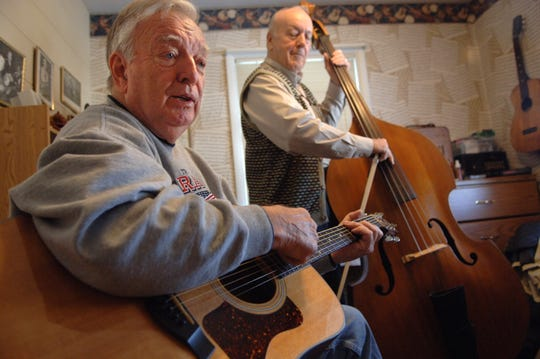 "Hal Wolford, left, and David Gard rehearse for a ""Really Big Show"" performance in 2006. Wolford, whose ""Backroads"" segments were a fixture of local television news on WEHT until his retirement in January 1998, died on Monday."