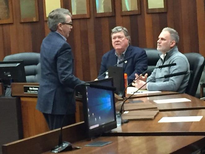 Evansville Mayor Lloyd Winnecke, left, spoke to City Councilors Ron Beane, center, and Zac Heronemus before the council's Feb. 24, 2020, meeting at the Civic Center.