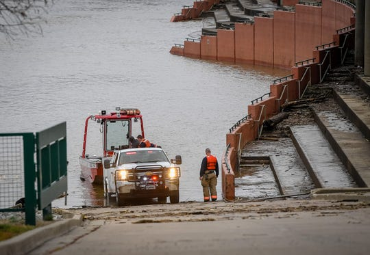 Evansville Fire Department members launch a boat at Dress Plaza to look for a possible body in the Ohio River near the Twin Bridges Tuesday, February 25, 2020.