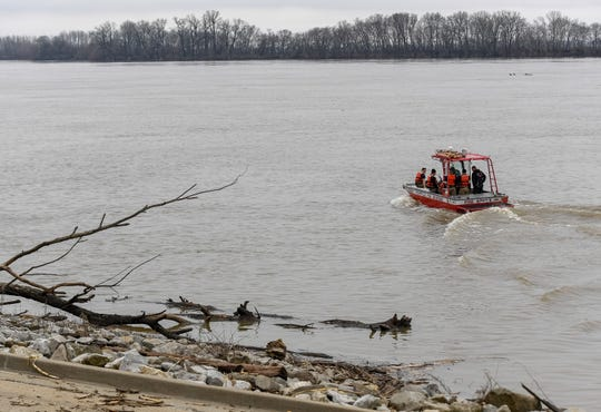 Evansville Fire Department members launch a boat at Dress Plaza to look for a possible body in the Ohio River near the Twin Bridges Tuesday, February 25, 2020. It ended up being a false alarm as a passerby saw what they thought was a body in the water near the bridge wearing orange clothing that turned out to be a construction barrel, Evansville Fire Department District Chief Amy Smith said. During the recovery effort, lanes of traffic were shut down on the Twin Bridges. All lanes of traffic were repoened by 3:45 p.m.