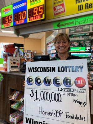 Julie Hansen, owner of Hansen's BP, celebrates the selling of a $1 million lottery ticket at her business.