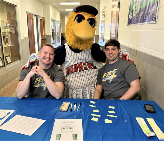 Ben Meade and Nick Beebe pose with Muddy, the Toledo Mudhens mascot.
