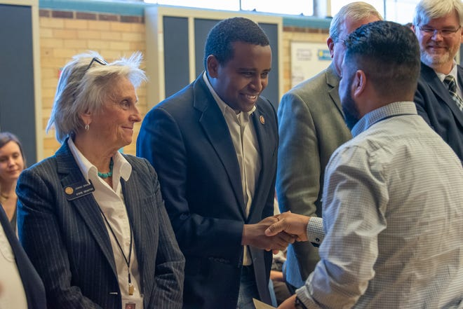 U.S. Representative Joe Neguse congratulates a new United States citizen during a naturalization ceremony at Dunn Elementary School in Fort Collins on Friday, February 21, 2020.