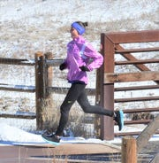 Dani Cook runs across a bridge on the Power Trail near Trilby Road in southeast Fort Collins on Feb. 18, 2020, while training for the U.S. Olympic Marathon Trials. Cook, who had her first child 10 months ago, qualified for the Trials in June 2018.