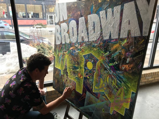 Green Bay artist Andrew Linskens works on an On Broadway-themed painting during Tuesday morning's State of the Broadway District event. On Broadway announced it will host a public art exhibition in August that features 25 works by local artists to celebrate On Broadway's 25th anniversary.